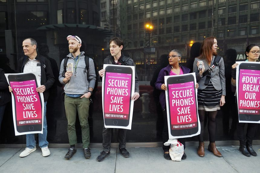 Protesters rallying in support of Apple in San Francisco last month. Apple argues that the court order - requiring it to write new software to disable passcode protection and allow access to an iPhone used by one of the San Bernardino shooters - would set