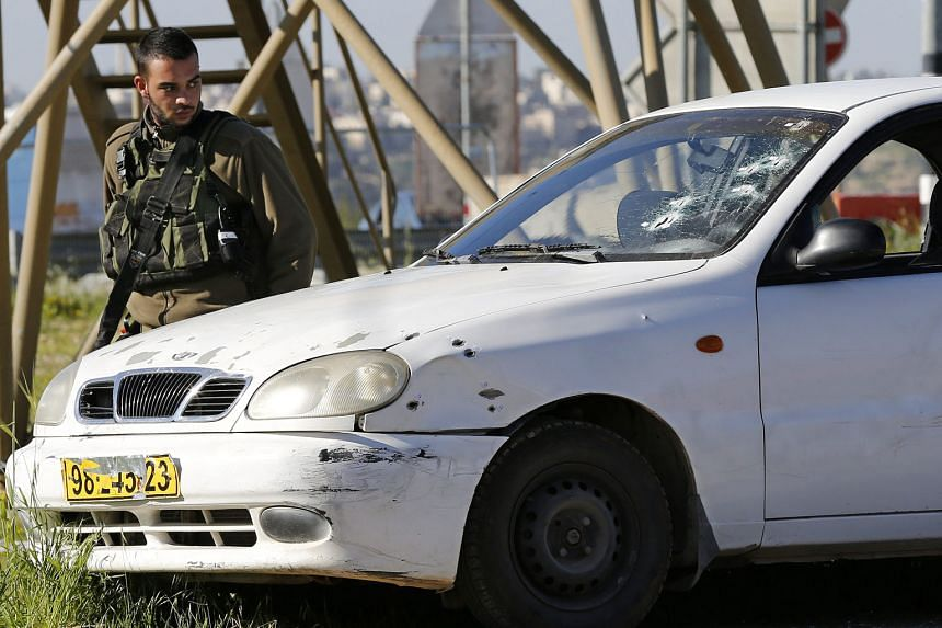 The car driven by the Palestinian woman who rammed it into an Israeli soldier, injuring him, yesterday in the occupied West Bank. She was shot dead by other soldiers.