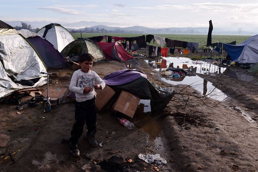 The misery in camps along the Greek-Macedonian border worsened yesterday after a night of driving rain. Conditions are particularly bad at the Idomeni crossing where 12,000 are stranded after Austria and the Balkan states imposed an entry cap.