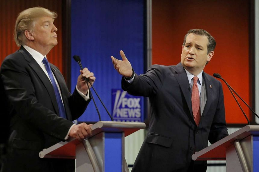 Ted Cruz gestures at rival candidate Donald Trump at the Republican presidential candidates debate in Detroit, Michigan.