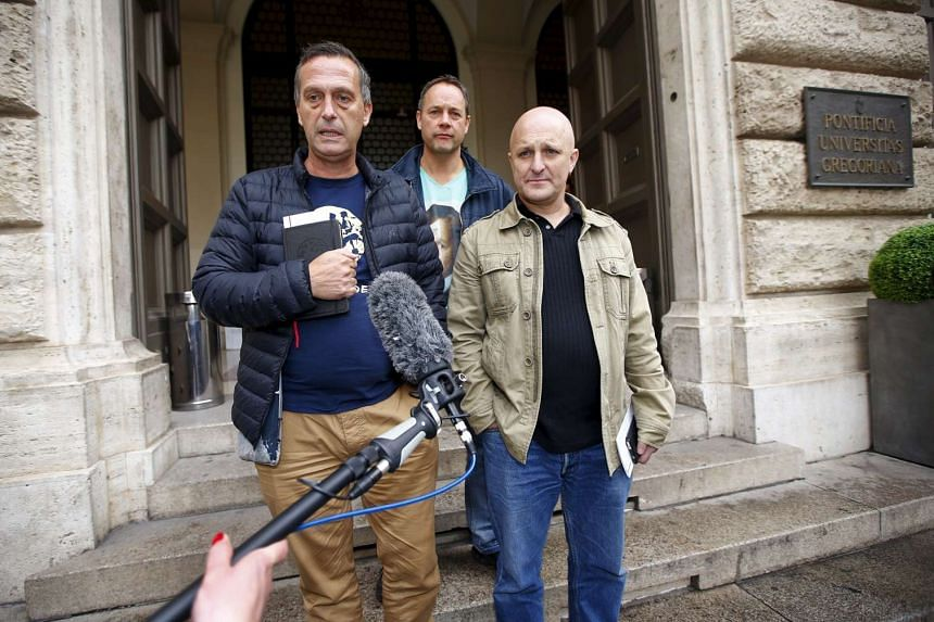 (From left) David Ridsdale, Peter Blenkiron and Andrew Collins speak to the media at the end of a meeting at the Gregoriana University in Rome.
