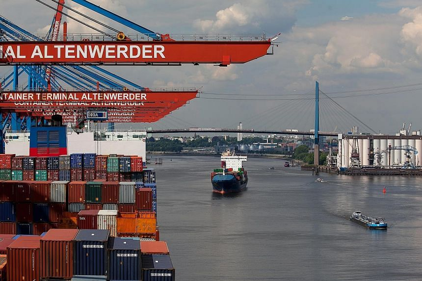 Left: Far fewer goods are being shipped across borders by container these days as the digital economy takes hold and global supply chains shorten.