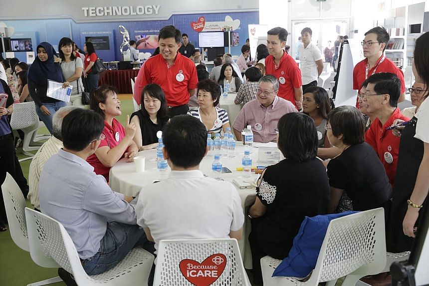 Mr Chan (standing, left) interacting with participants at a People's Association SGfuture session yesterday. It focused on lifelong learning for senior citizens and how the community can support them - which the PA hopes to do by linking them up with
