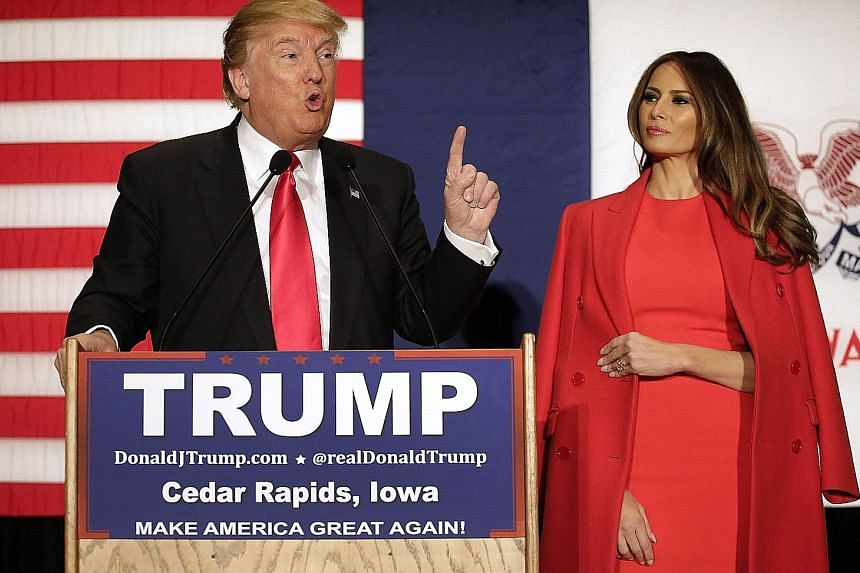 Above: Slovenian model Melania Knauss appearing on the cover of GQ magazine in January 2000. She and Mr Trump were dating at the time. Left: Mr Trump and wife Melania at a campaign event at the US Cellular Convention Centre on Feb 1 in Cedar Rapids,