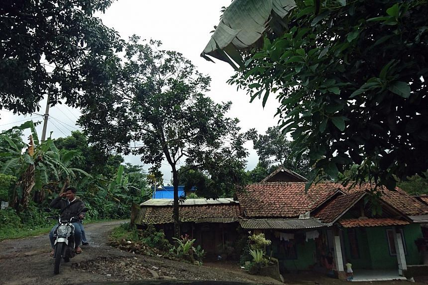 (Above) The dirt trail leading to Pondok Pesantren Ibnu Mas'ud, an Islamic boarding school in Bogor, is barely wide enough for a small car or pick-up truck. (Below) Mr Jumadi, a staff member who claims he handles the school's community relations, say