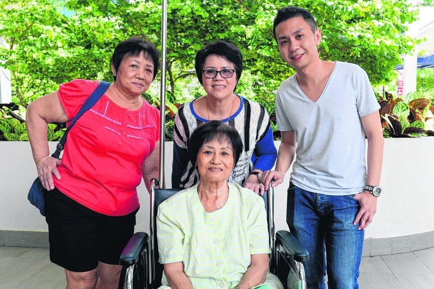 (Left): Madam Sim (seated) with her sisters (from left): Sim Lee Chuan, 67, and Sim Peck Chuan, 62, and nephew Keith Ng. (Above): The picture of Madam Sim's legs that Mr Ng posted on his Facebook page in a plea for help.