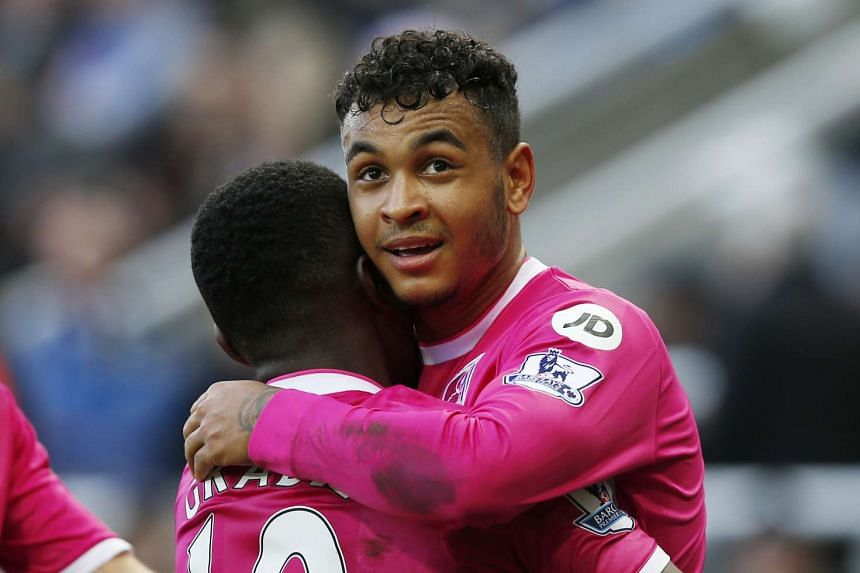 Bournemouth's Joshua King celebrates their first goal an own goal by Newcastle's Steven Taylor.