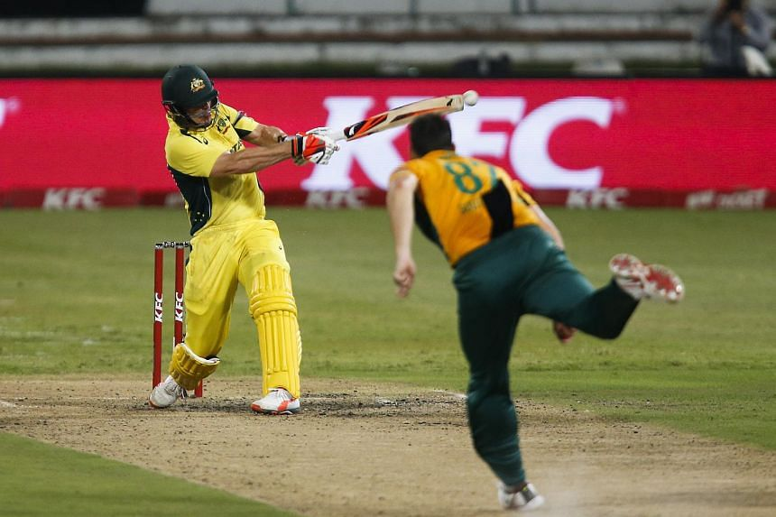 Australia's Nathan Coulter-Nile plays a shot off the bowling of South Africa's Kyle Abbott (right) during the T20 International cricket match in South Africa, on March 4, 2016.