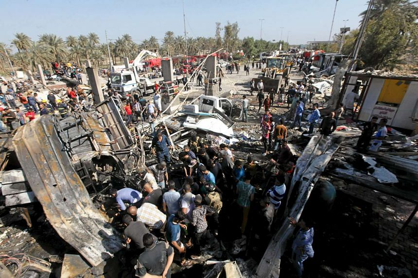 Residents gathering at the site of a suicide bombing in Hilla, south of Baghdad, on March 6, 2016.
