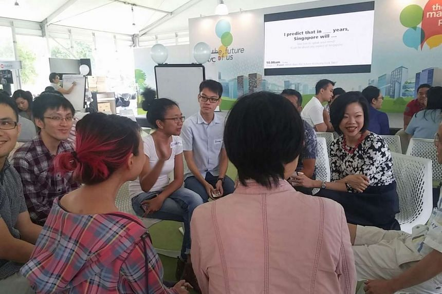 """Ms Sim Ann (extreme right) speaking to participants at """"The Future of the Economy"""" engagement session on Sunday (March 6)."""