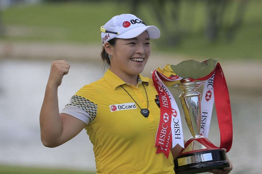 South Korea's Jang Ha Na posing with her trophy after winning the HSBC Women's Champions at the Sentosa Golf Club.