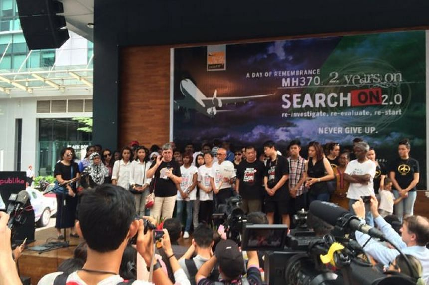 About 150 people attended the ceremony at the square of a Kuala Lumpur shopping mall.