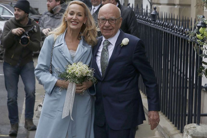Media mogul Rupert Murdoch (right) and former supermodel Jerry Hall pose for a photograph as they arrive for their wedding reception in London.