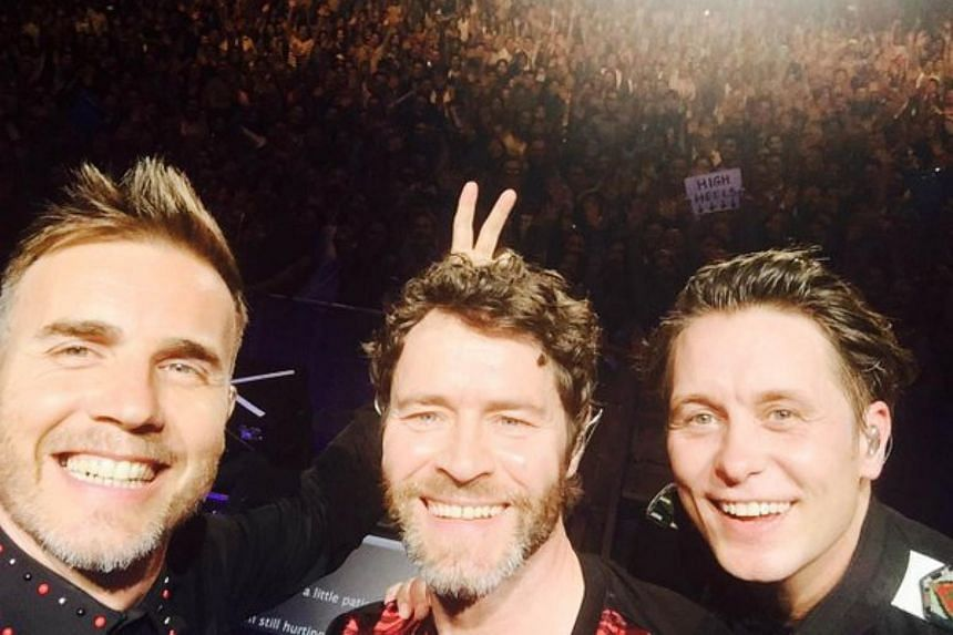 Take That members  Gary Barlow, Howard Donald and Mark Owen performing in Bangkok, Thailand, on March 3, 2016.