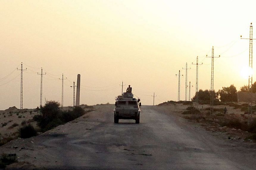 An Egyptian military vehicle is seen on the highway in Egypt's northern Sinai in a May 25, 2015 photo.