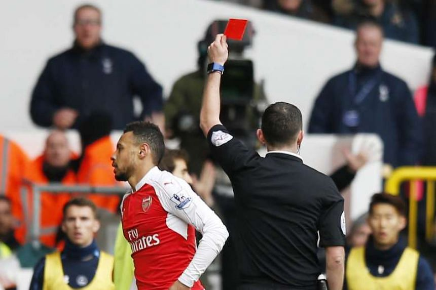 Arsenal's Francis Coquelin is shown a red card by referee Michael Oliver for a foul on Tottenham's Harry Kane (not pictured).