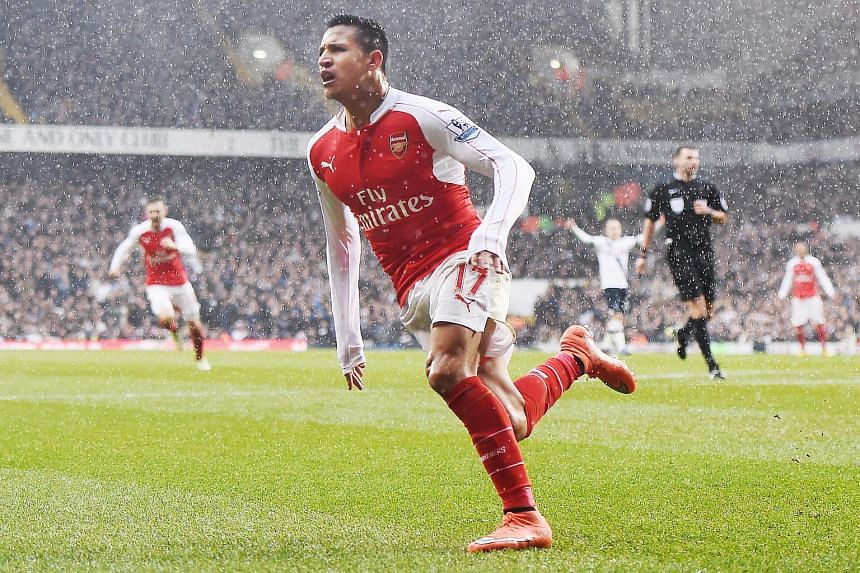 Arsenal's Alexis Sanchez celebrates after scoring against Tottenham during their English Premier League football match.