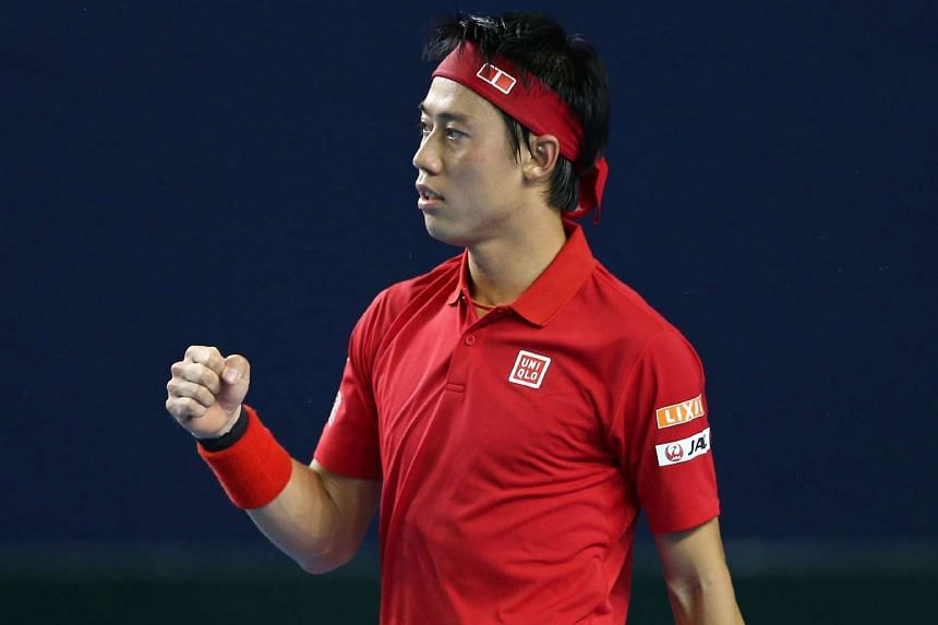 Japan's Kei Nishikori celebrating after winning his Davis Cup match against Britain's Daniel Evans on March 4, 2016.