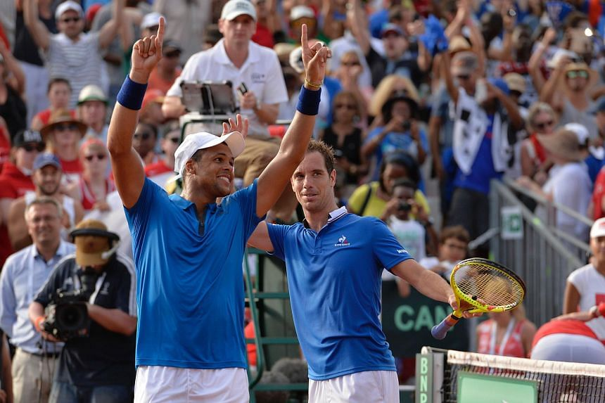 France tennis players Jo-Wilfried Tsonga (left) and Richard Gasquet celebrate after winning the Davis Cup World Group first-round double match, on March 5, 2016.