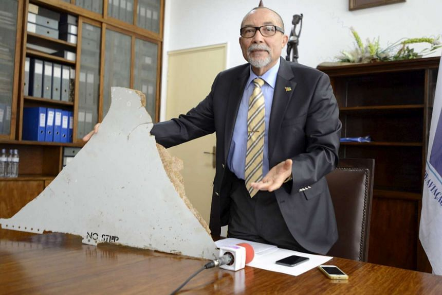 Comandante Joao Abreu, the head of Mozambique's Civil Aviation Institute, shows a piece of debris believed to be from MH370, on March 3, 2016.