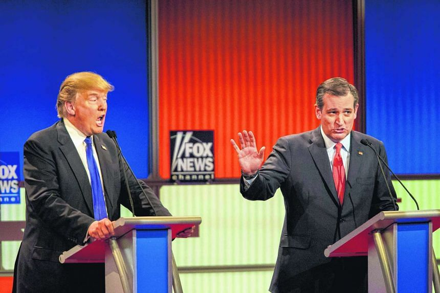 Republican presidential candidates Ted Cruz (right) and Donald Trump spar during the Republican presidential debate in Detroit on March 3, 2016.