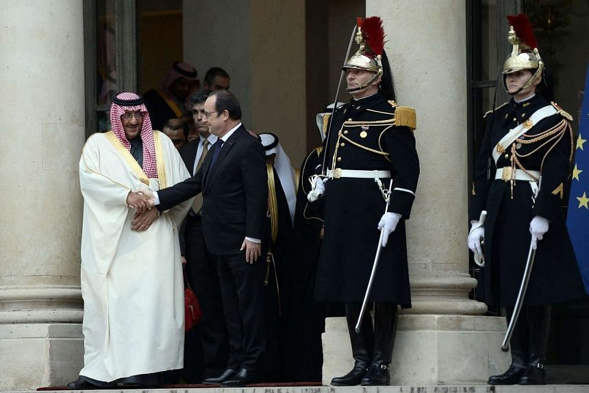 French President Francois Hollande (second from left) shakes hands with Saudi Crown Prince Mohammed bin Nayef at the Elysee Presidential Palace in Paris on March 4, 2016.