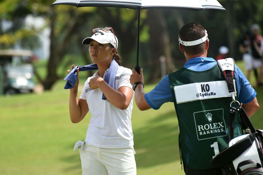 The searing afternoon sun took its toll on the golfers. Thankfully for New Zealand's Lydia Ko, she had caddy Jason Hamilton on hand to keep her cool.