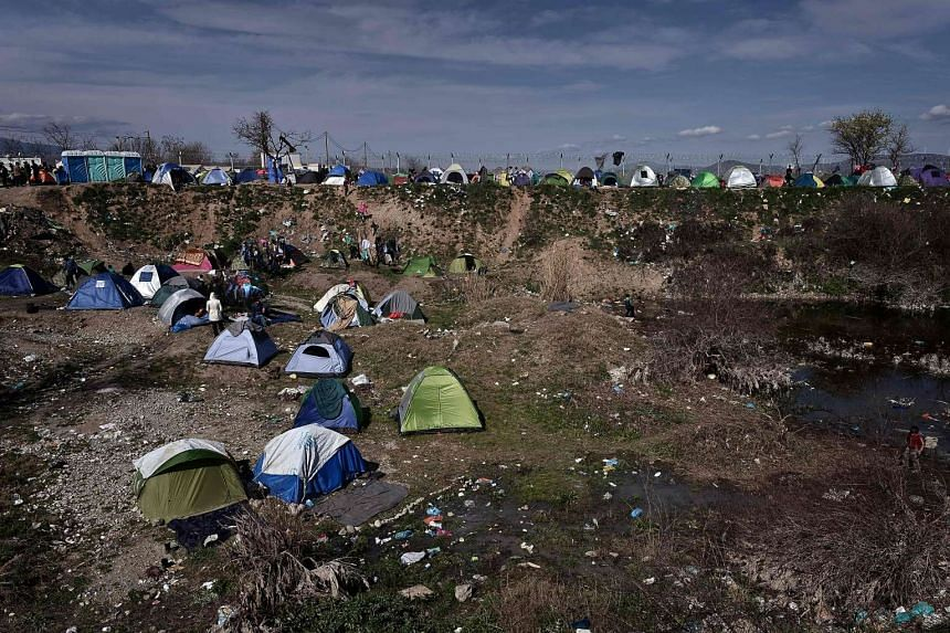 Tents staged in a makeshift camp next to the border fence of the Greek-Macedonian border.