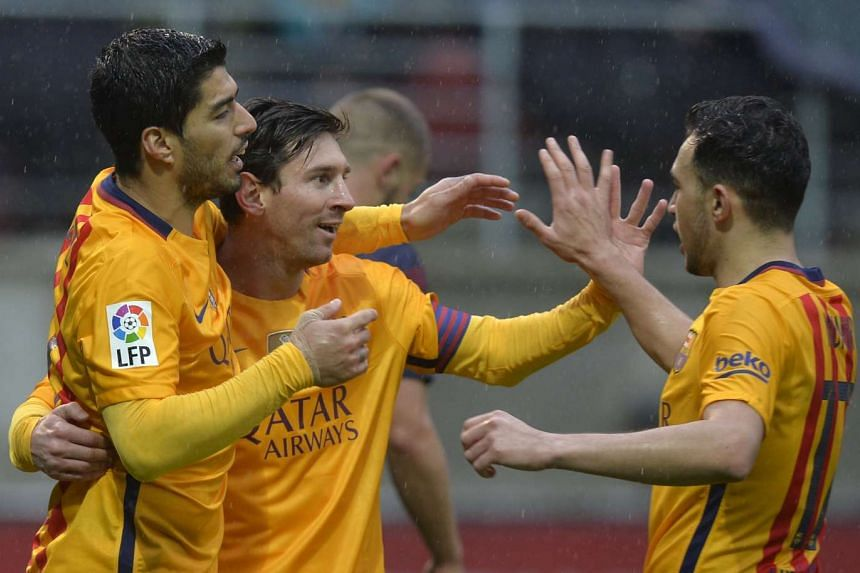 Barcelona's Luis Suarez, Lionel Messi and Munir el Haddadi react after a penalty goal by Messi in Ipurua stadium, Eibar, Spain on March 6, 2016.