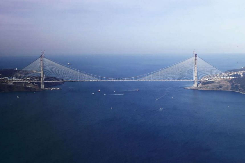 A handout picture released by the Turkish Prime Minister press office on March 6, 2016 in Istanbul, shows an aerial view of the Yavuz Sultan Selim Bridge, the day of its completion.