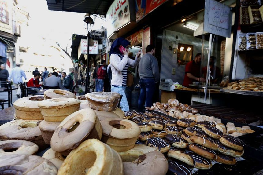 Syrians seen in one of the markets in the capital Damascus, Syria, on March 6, 2016. Russian-US brokered ceasefire entered its second week the day before, having drastically reduced the death toll in this war-torn country.