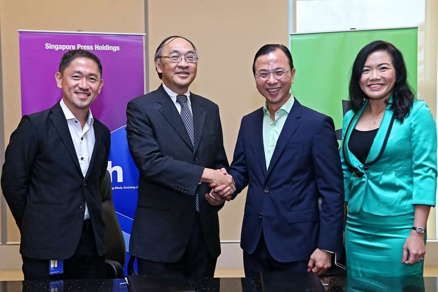 (Left to right) Mr Anthony Tan, executive vice-president of SPH's Chinese Media group and Media Strategy and Analytics arm, SPH chief executive officer Alan Chan, StarHub chief executive officer Tan Tong Hai and StarHub chief strategic partnership