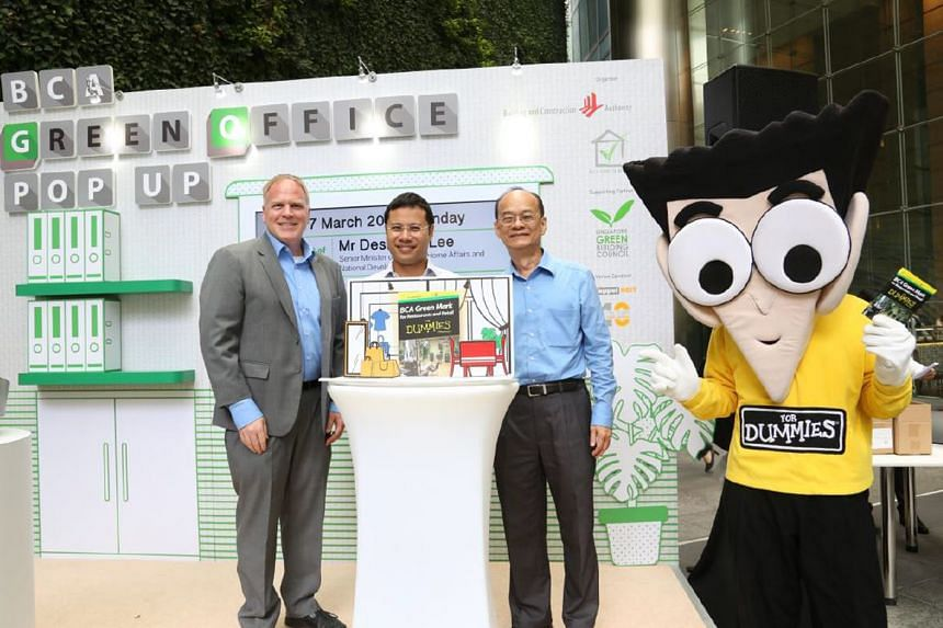 Senior Minister of State for National Development Desmond Lee (centre) at the launch of the BCA Green Mark for Restaurants and Retail For Dummies, together with Mr Erik Thrasher, GM and Marketing Director, Asia, Wiley (left) and Mr Lam Siew Wah, BCA'