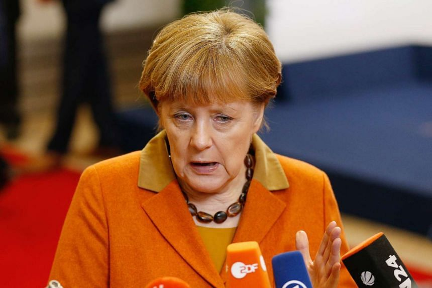 German Chancellor Angela Merkel speaks to media during an extraordinary summit of European Union leaders with Turkey in Brussels on March 7, 2016.