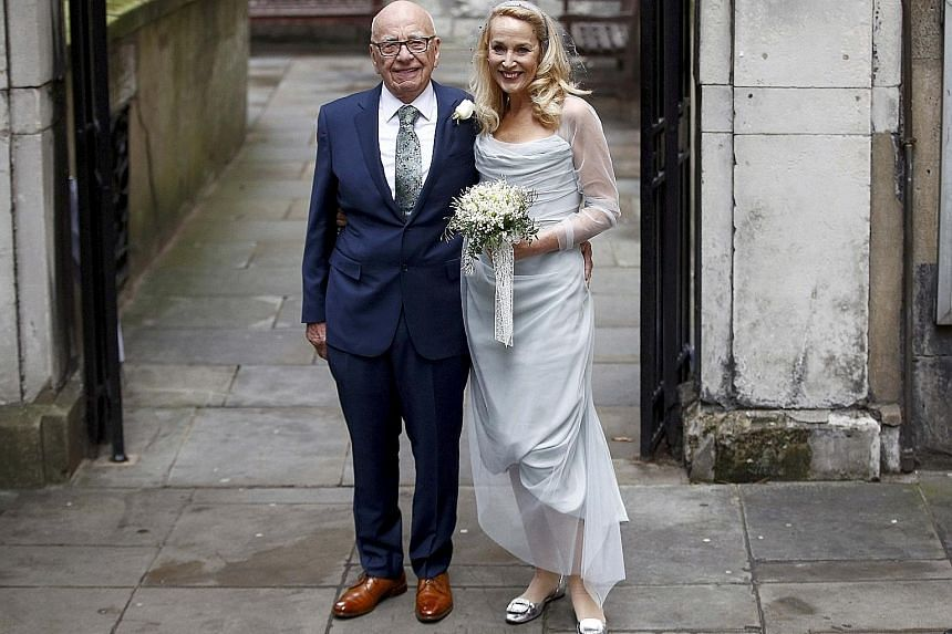 Rupert Murdoch and Jerry Hall outside St Bride's Church following a service to celebrate their wedding, which took place last Friday.