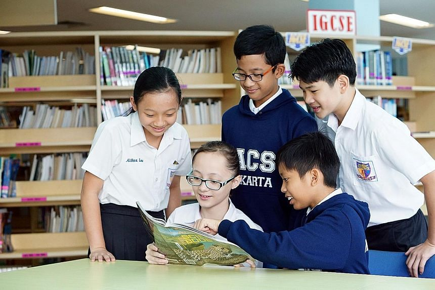 """Grade 6 pupils at Anglo-Chinese School (International) Jakarta use Singapore textbooks for subjects such as science. Across Asia, such """"Singapore- styled"""" institutions have been growing over the years."""