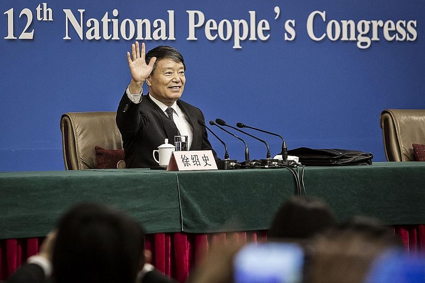 Mr Xu Shaoshi, at a news conference on the sidelines of the fourth session of the 12th National People's Congress in Beijing yesterday, gave assurances that China would weather the current slowdown.