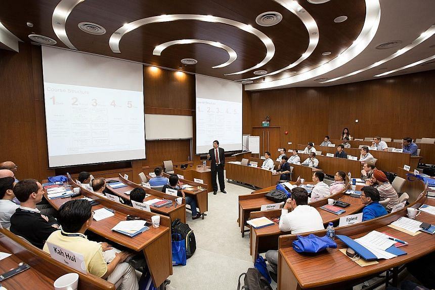 A class at Nanyang Technological University. Graduates from its business and computing double degree programme took home a gross median monthly salary of $4,583 last year. This put their salaries almost on a par with those who studied law or medicine