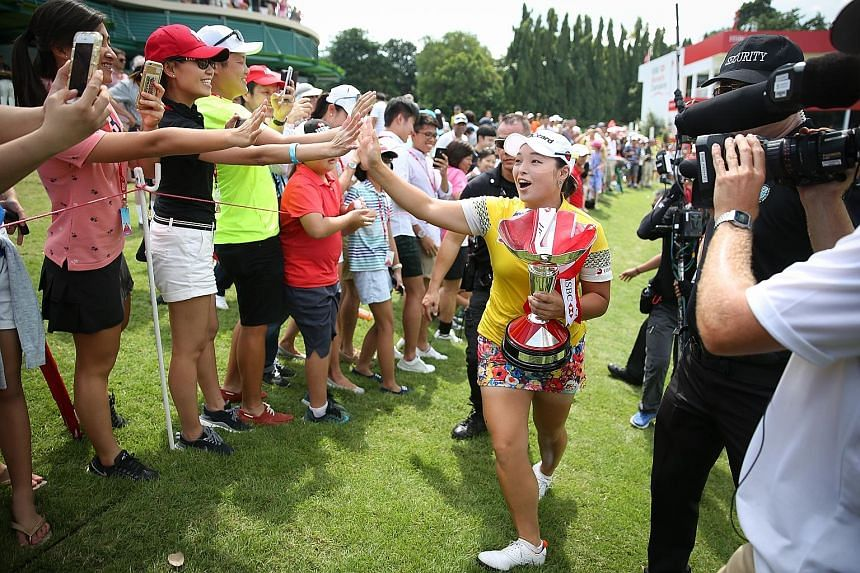 South Korean golfer Jang Ha Na, 23, going on a lap of honour around the 18th green of Sentosa Golf Club's Serapong course with her HSBC Women's Champions trophy in tow. The world No. 10 shot a seven-under 65 yesterday for a 269 winning total at the U