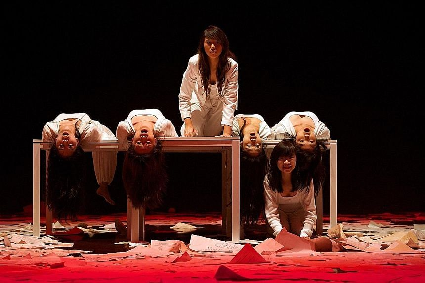 "Ms Sim (third from left) performing in a production of Kuo Pao Kun's The Spirits Play. After her A levels in 2013, she shelved her pursuit of a degree to explore her passion in theatre. ""I am more focused in university now because I have a clearer s"