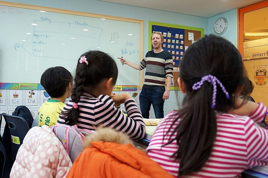 English language teacher Keegan Price conducting a class at a private English language institute. Seoul bans the teaching of English in the first two years of primary school, both public as well as private.