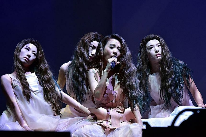 Dancers were dressed up to look like singer Hebe Tien (third from far left) in a segment of the concert.