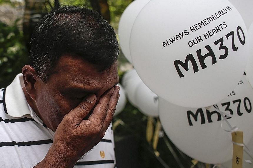Mr Zamani Zakaria, who lost two relatives on Flight MH370, in tears at yesterday's event organised by support group Voice370. The information void has led to multiple lawsuits being filed the past week by families as the March 8 deadline for legal ac