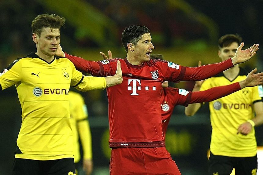 Polish national team-mates, Dortmund defender Lukasz Piszczek (left) and Bayern striker Robert Lewandowski, arguing with a decision in their 0-0 Bundesliga draw, which kept the Bavarians five points ahead.