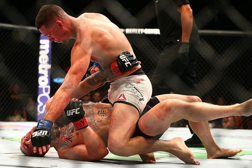 American Nate Diaz pins featherweight champion Conor McGregor against the mat, eventually choking him into submission during their UFC 196 bout in Las Vegas. Saturday's fight was the Irishman's brave but failed attempt in moving up a weight division.