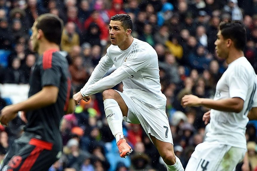 Portuguese forward Cristiano Ronaldo scoring one of his four goals against Celta Vigo in Madrid. He is now the second-highest scorer in Primera Liga history with 252 goals in only 228 games.