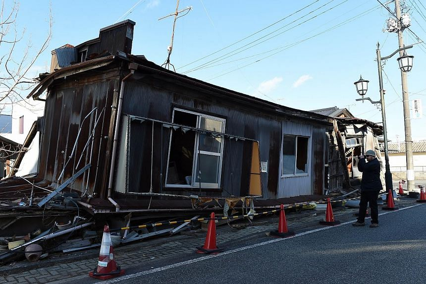 A visitor touring Namie, Fukushima, last month. The disaster-hit areas draw over 2,000 annual visitors, keen to see the aftermath of the nuclear accident five years ago.