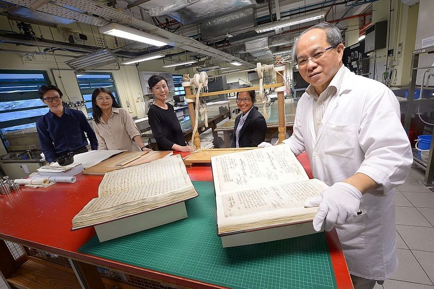 From left: Mr Wong, Dr Phang, Ms Chee at the Archives Conservation Laboratory with assistant archivist Abigail Huang and Mr Chng.