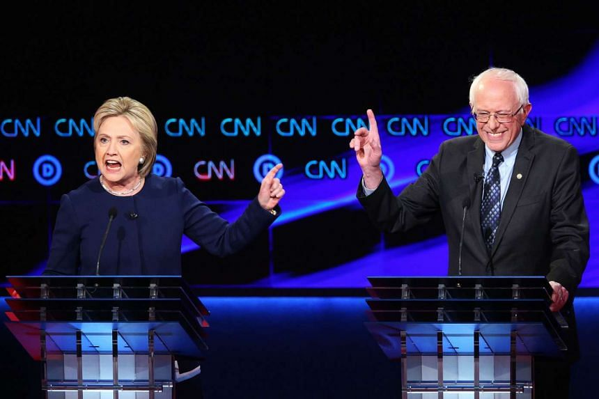 Democratic presidential candidate Senator Bernie Sanders and Democratic presidential candidate Hillary Clinton speak during the CNN Democratic Presidential Primary Debate at the Cultural Centre Campus on March 6, 2016 in Flint, Michigan. Voters in Mi