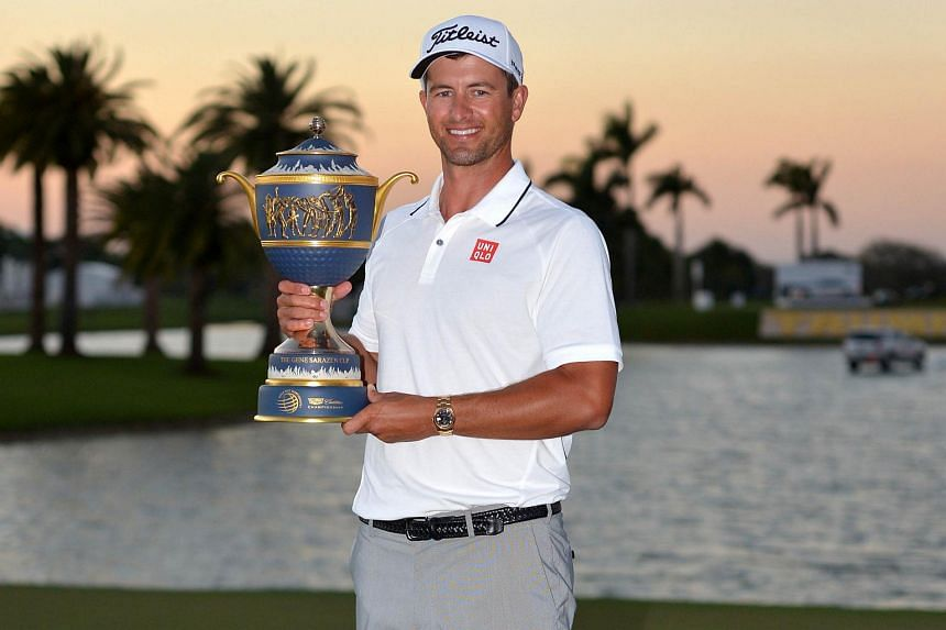 Golfer Adam Scott poses with the trophy at the WGC-Cadillac Championship in Florida, on March 6, 2016.
